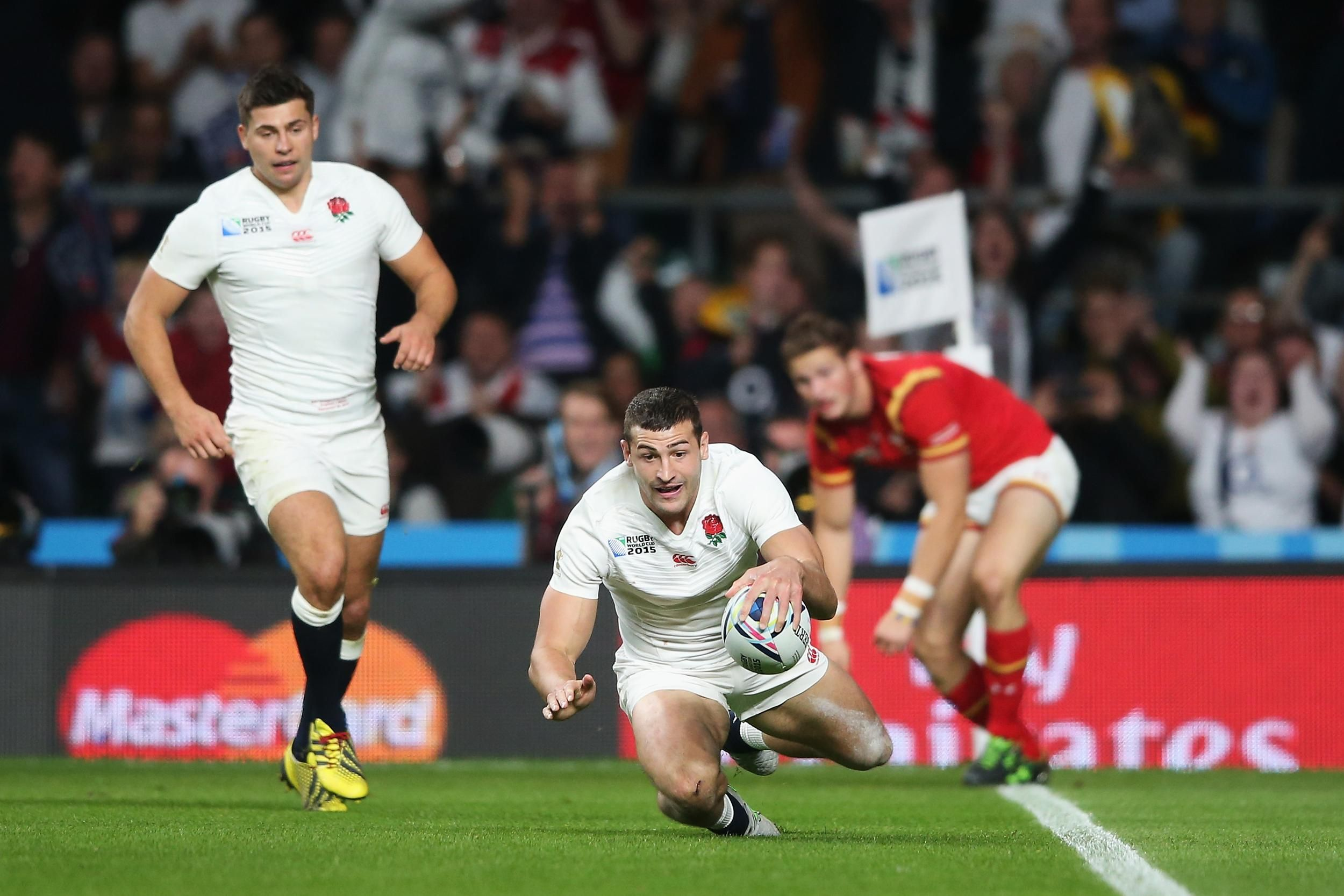 JONNY BE GOOD: England's Jonny May dives over the line to score's the opening try against Wales