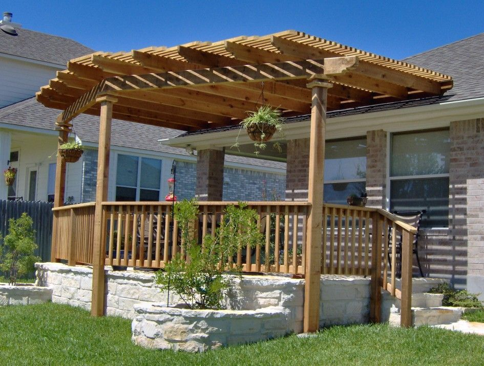 exterior backyard patio pergola ideas design with wooden rail half fencing on white stone like concrete - Patio Pergola Ideas