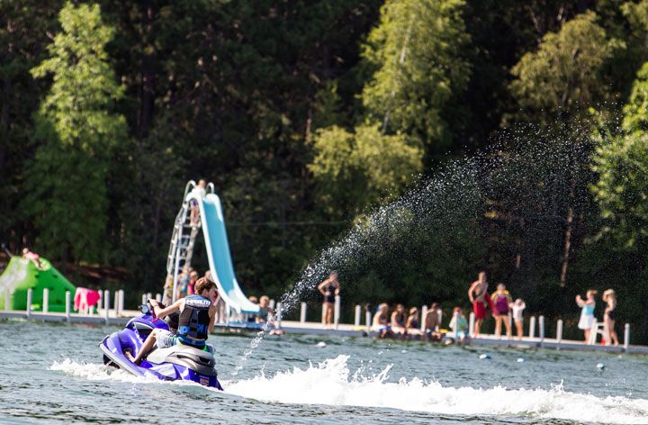 A Jet Skier Zips Past Trout Lake Camp On Big Trout Lake In Crosslake