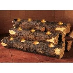 I think my husband has a bit for his drill that makes huge holes in wood. He could make these!  Log Fireplace Candle Holder.