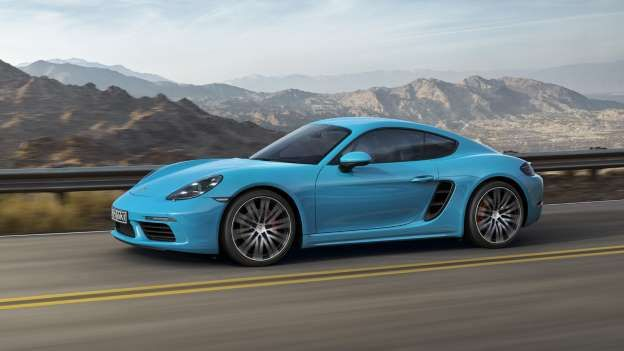 The Porsche Cayman Is A Two Seater Mid Engine Sports Coupe Revitalizing Spirit And Nostalgia Of