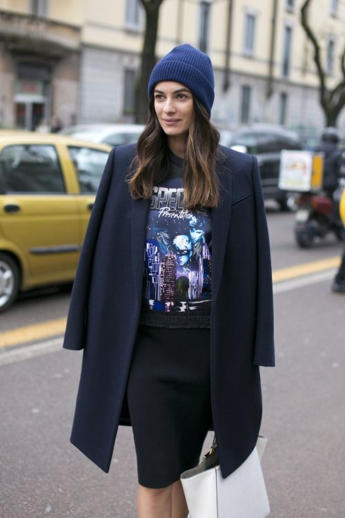 Black skirt with print t-shirt, dark blue coat and blue wool hat. #coat #skirt