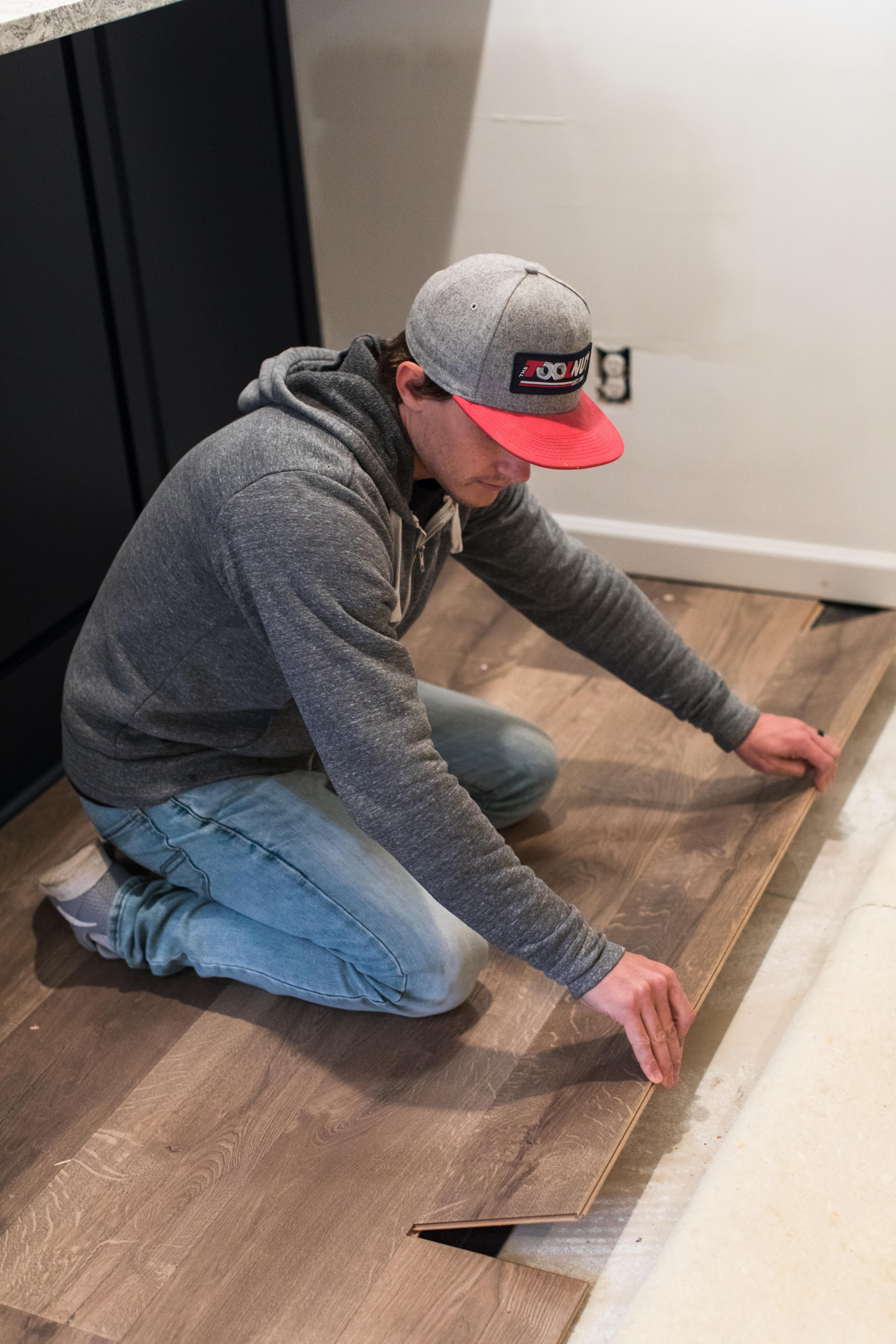 How To Install Laminate Flooring Over A Tile Floor Today S Homeowner Installing Laminate Flooring Installing Laminate Wood Flooring Flooring