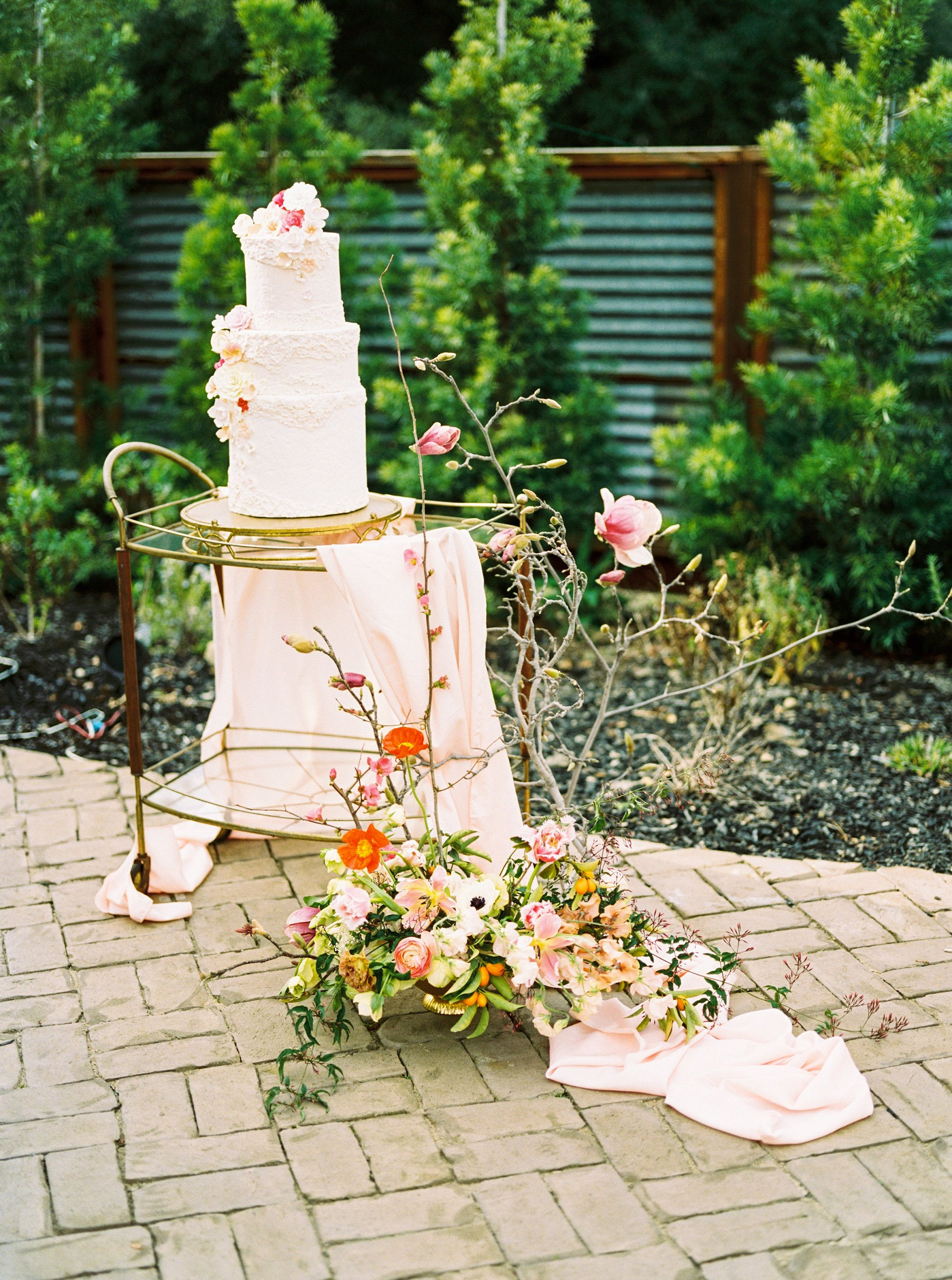 Wedding cake table decor ideas  A silk table runner goes a long way in enhancing the decor of your