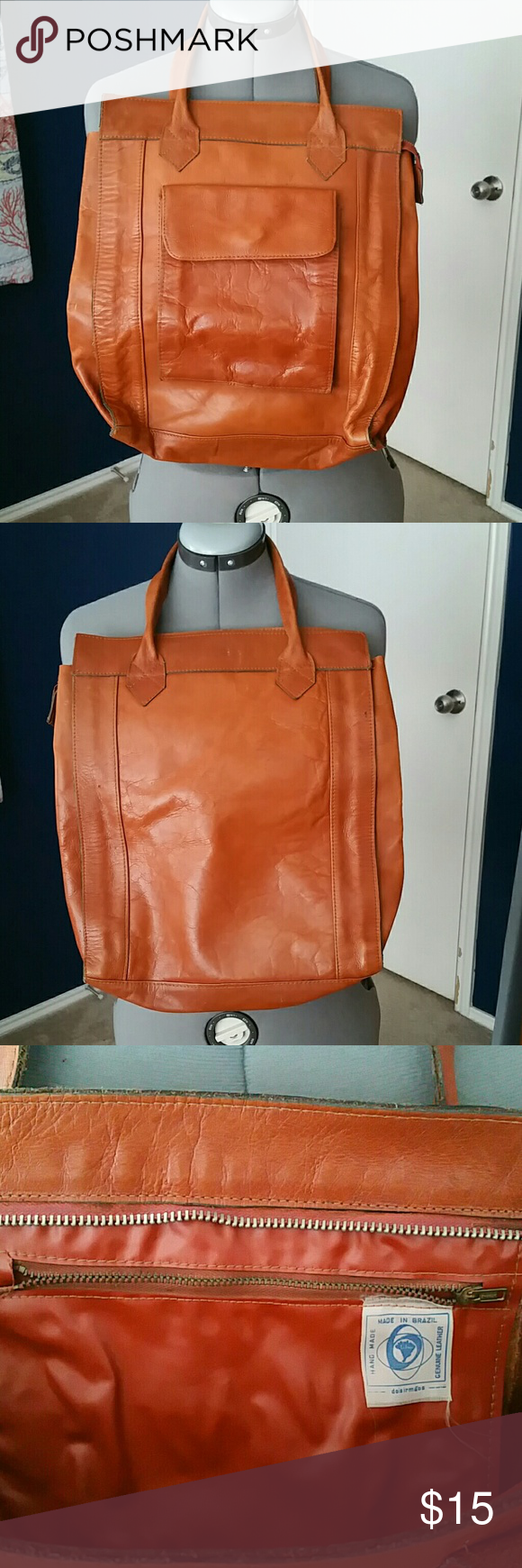 Vintage leather tote Metal top zip. One interior, one exterior pocket Handles good Made in Brazil Bags Totes