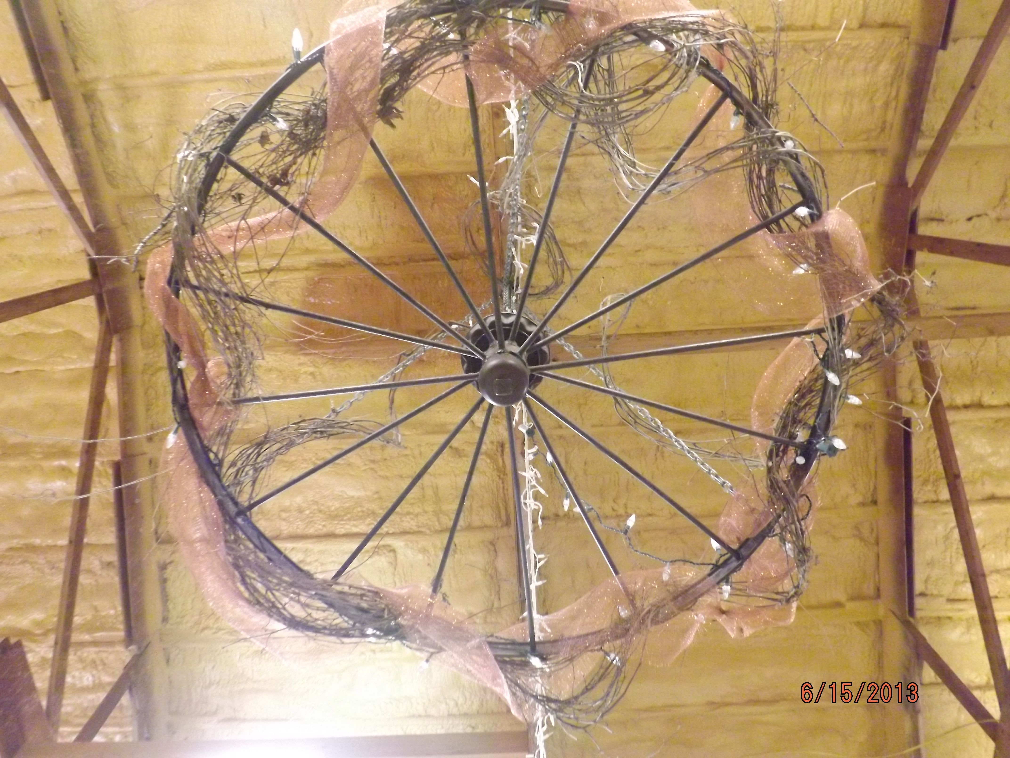 Wagon wheel decked out for wedding reception chandelier diy