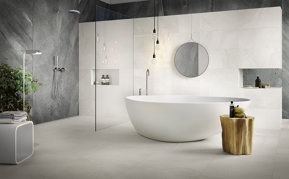 Stone look #Comblanchien tile for total white bathroom design. #ceramichecaesar #caesarceramics #totalwhite #bathroom #design #interiordesign #tiles #porcelaintiles #mirror #bath #white #surfaces #walls #floors