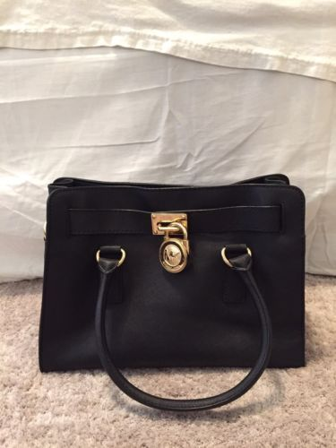 Black Michael Kors Staffiano bag! Practically new! https://t.co/AQMCsNqRCp https://t.co/o4udCprlYI