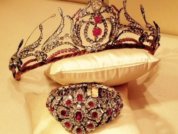 Ruby and diamond tiara, second half of the 19th century. Designed as a series of foliate sprays set with circular-cut, cushion-shaped and rose diamonds, later embellished with circular-cut rubies centred on a similarly set lyre motif, inner circumference approximately 290mm, five small diamonds deficient. Property from the estate of Mary, Duchess of Roxburghe.