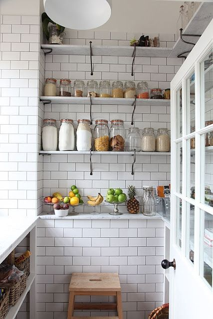 Love the wire brackets against the subway tile Kitchen organization