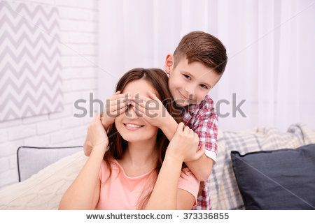 Son closing his mother eyes with his hands