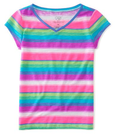 """Why settle for a boring top when you can wear our Blanket Stripe V-Neck Tee?! It's decorated with an allover multicolored pattern, while the soft material promises max comfort. Pair it with all your favorite shorts and skinnies.<br><br>Tag free label.<br>Relaxed fit. Approx. length (10): 21""""<br>Style: 2997. Imported.<br><br>60% cotton, 40% polyester.<br>Machine wash/dry."""