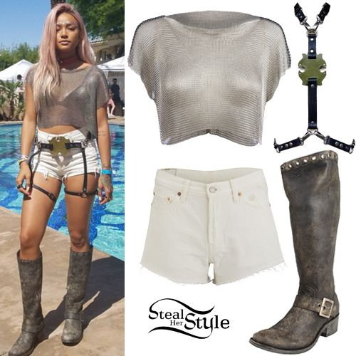 Karrueche posed at day two of Coachella Valley Music and Arts Festival wearing a Fannie Schiavoni Metal Mesh Top (£980.00), Levi's Vintage Denim Shorts ($58.00), a Kenny Kenny Gear Leaf Harness ($220.00) and Old Gringo Anca Trov Boots ($250.00).