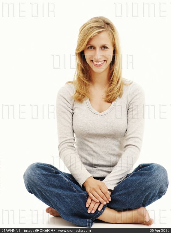 Woman Smiling While Sitting In A Cross-Legged Position - Stock Photo Tags Barefoot -7665