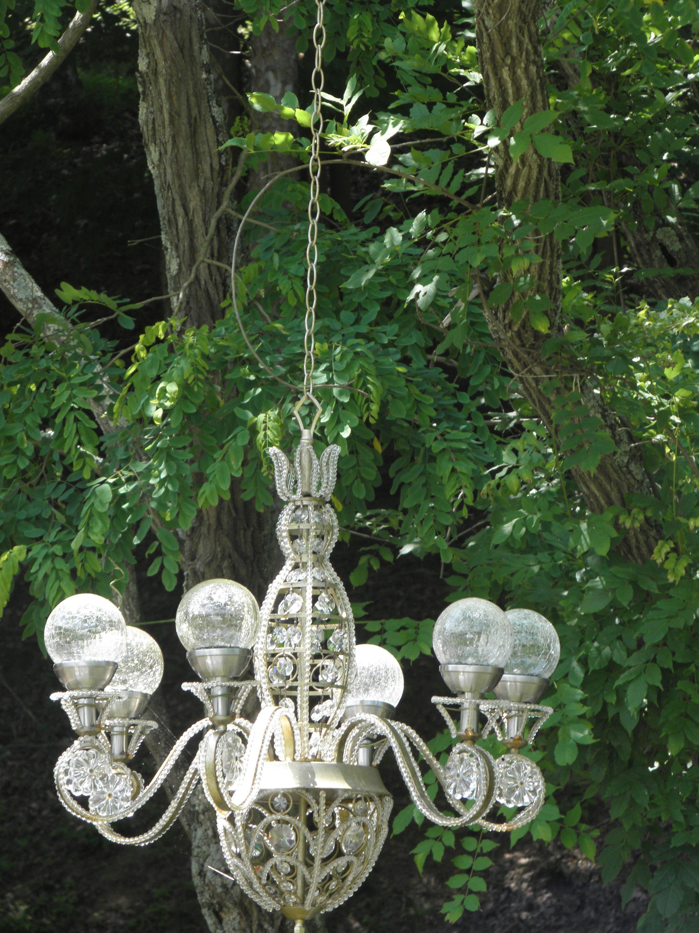 Solar Powered Chandelier In My Garden I Like The Round Balls Rather Than The Regular Kin Outdoor Solar Lights Backyard Solar Lights Outdoor Chandelier Wedding
