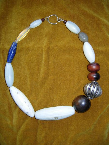 Old agate beads combined with African 'amber' silver, lapis lazuli and rock crystal Share Twitter Views: 14