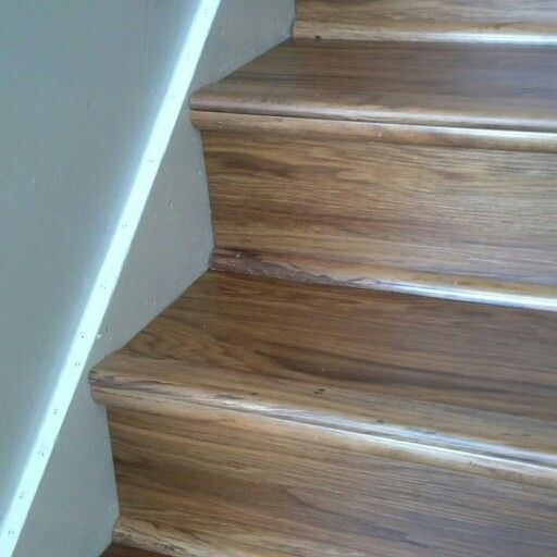 Luxury vinyl wood planks on stairs lvt vinylwood you ll for Vinyl flooring over vinyl