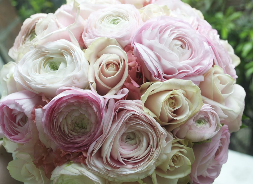 hand tied bouquet of blush pink and ivory roses ranunculus and lisianthus cream and