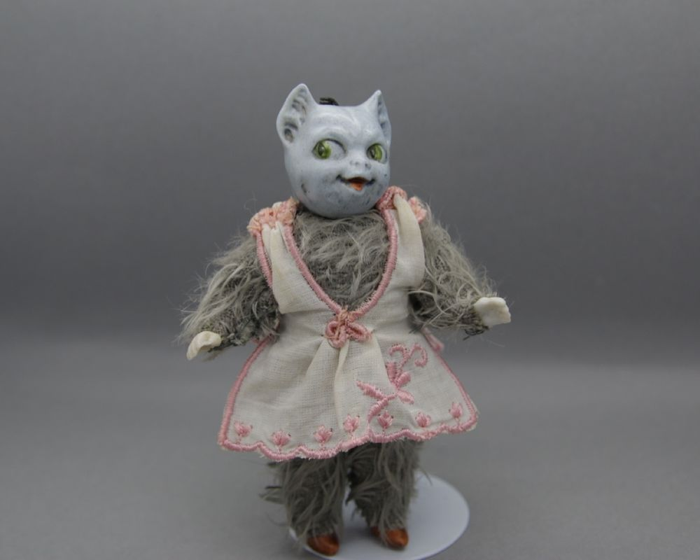 antique German bisque doll cat head with costume and mohair-fur  /Thüringen 1900
