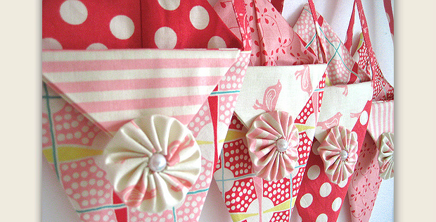 """Change the Fabrics to Suit the Occasion! These pretty little pockets are so much fun. Fill them with candy, flowers, fabric … whatever comes to mind and give them away for Valentine's Day. Or, as designerMonica Solorio-Snow says: """"Fill with treats and love… hang on a front door handle… ring the doorbell… and RUN!"""" Simply …"""