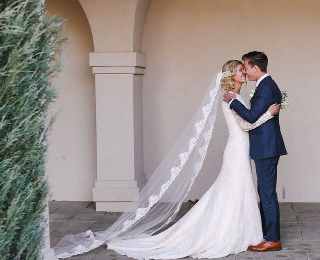 Love that he 39 s in a blue suit and love her lace veil for Modest wedding dresses seattle