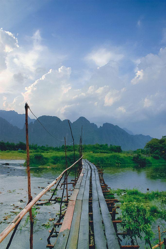 Bamboo Bridge, Laos Laos Travel Destinations   Laos Honeymoon   Backpack Laos   Backpacking   Laos Vacation   Laos Photography   Southeast Asia Budget Bucket List Wanderlust #travel #honeymoon #vacation #backpacking #budgettravel #offthebeatenpath #bucketlist #wanderlust #Laos #Asia #southeastasia #visitLaos #TravelLaos