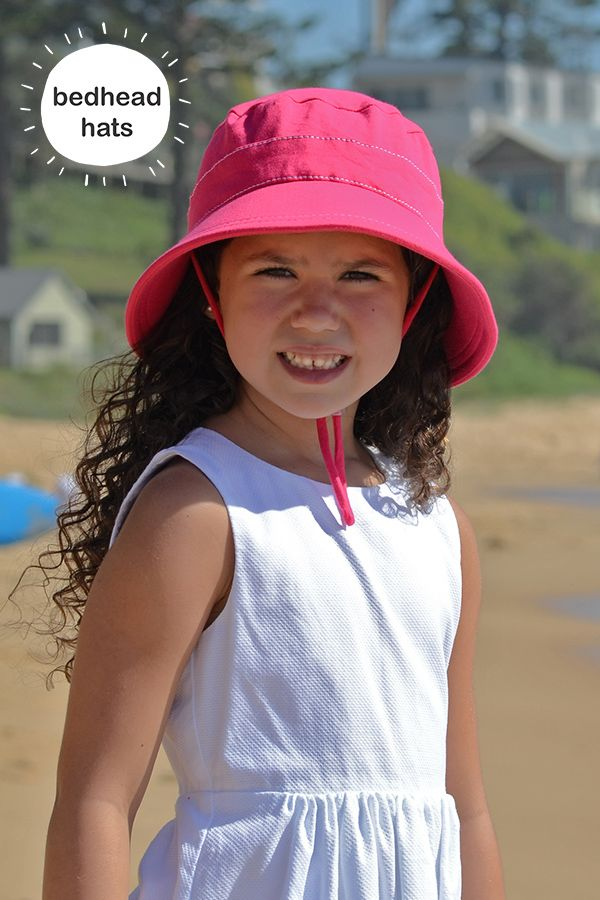 b8c3c9d4 UPF 50+ kids bucket sun hat with chin strap in bright pink will keep you  cool! #bedheadhats #kidshats #kidsfashion