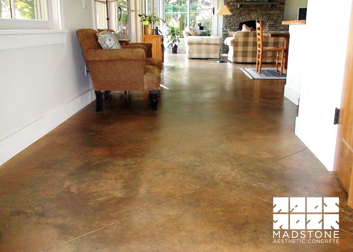 concrete floors  acid stained floor with custom tile in