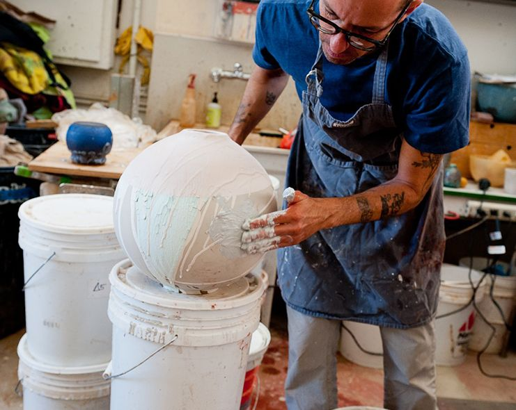 Adam Adding Glaze To A Vase In The Studio Artist At