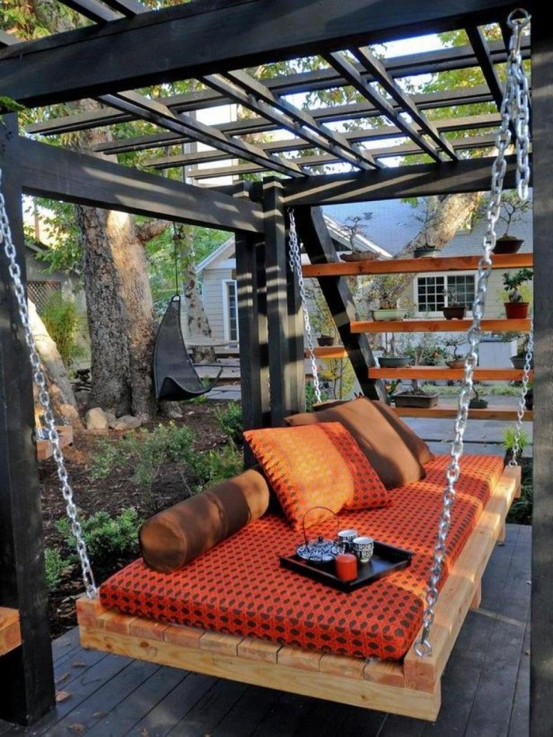 Asian outdoor daybed with orange color cover as comfortable place at