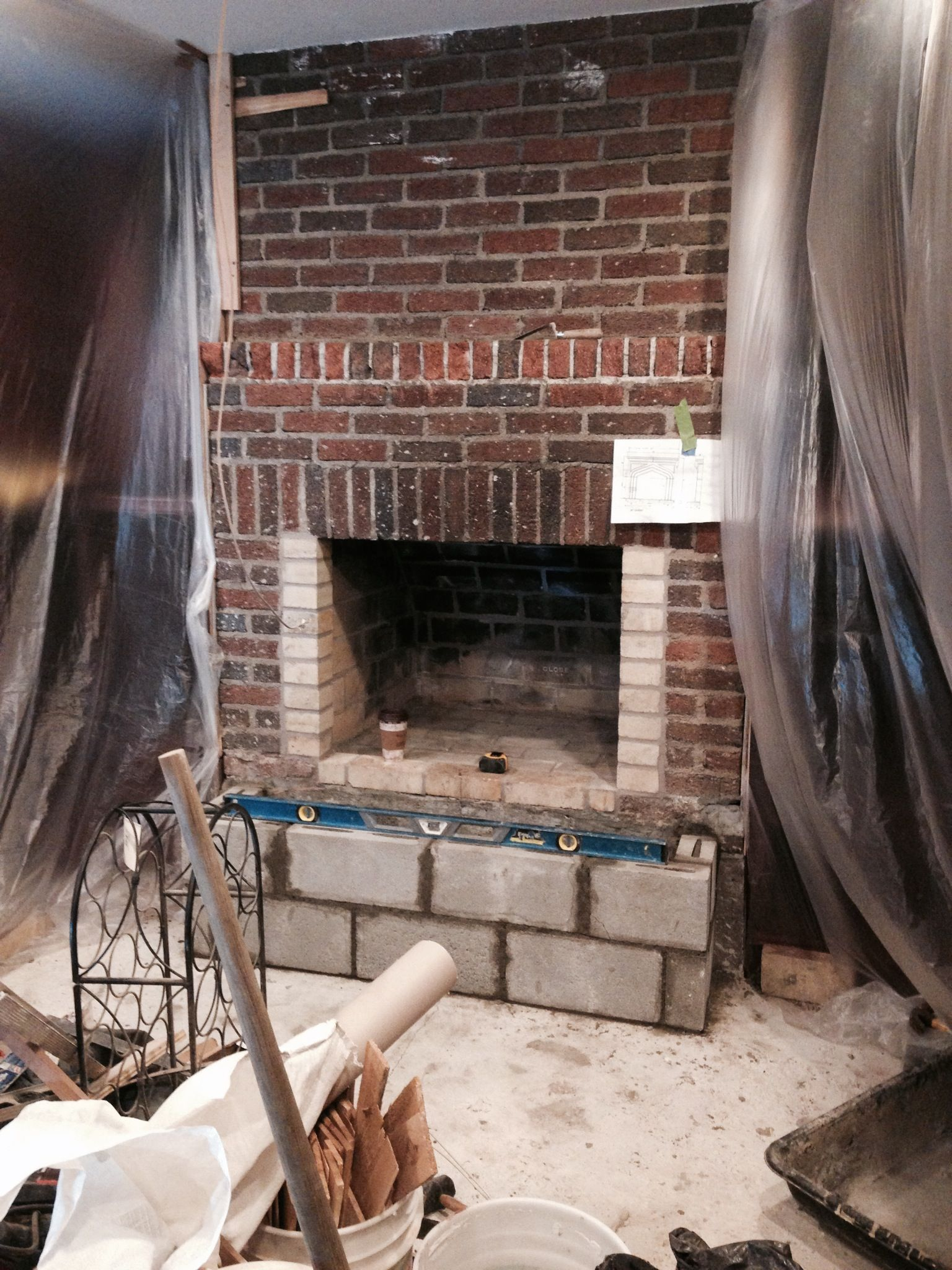 our client was tired of the drab brick fireplace in his home so he rh pinterest com