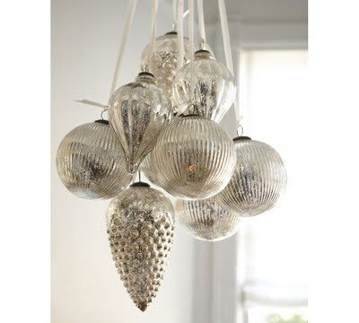 20 Easy-Peasy Christmas Decorations For The Regretfully Late Procrastinator; I have some similar silver/mercury glass ornaments that I hang from my DR chandelier by cream color ribbon...very elegant!