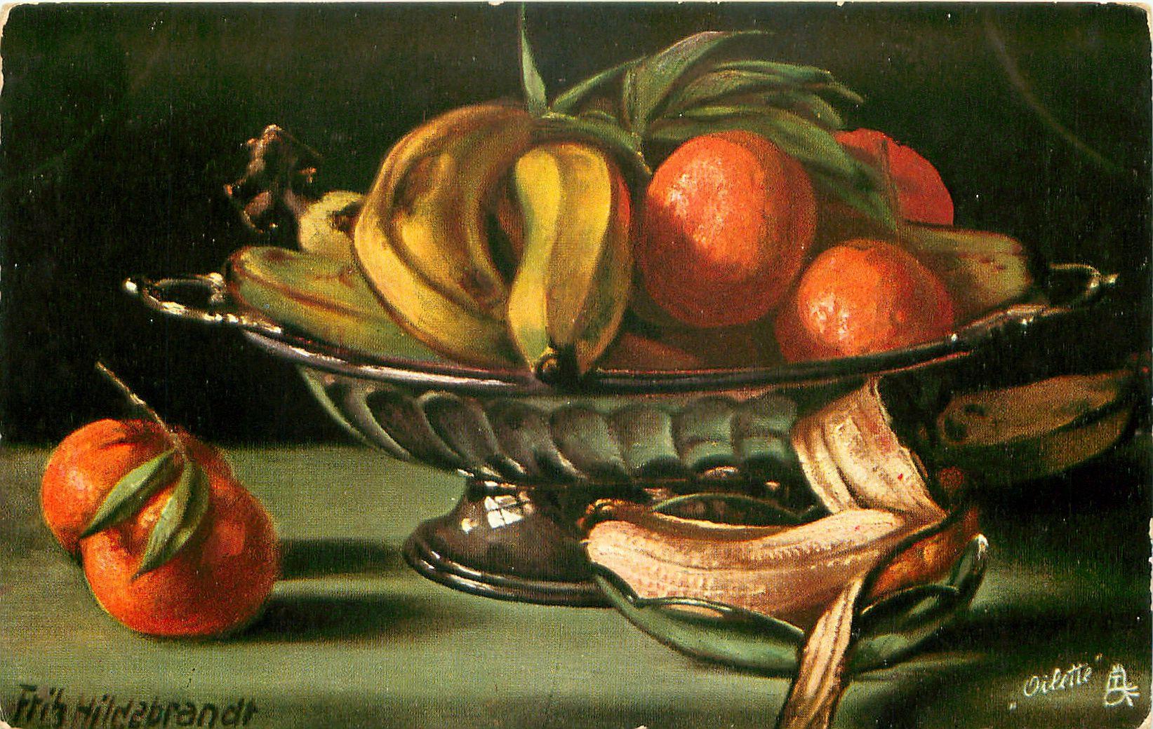 bananas & oranges in & around silver dish