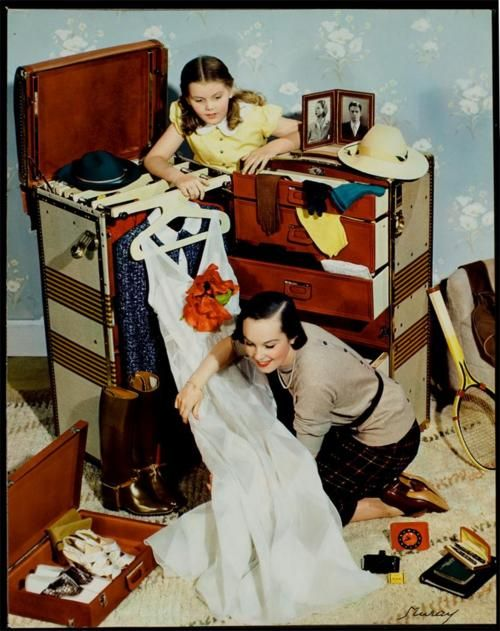 Photograph by Nickolas Muray for a of McCall;s magazine. (1942) Packing for the ship across the Atlantic ...two weeks trip! Dress for dinner every night and dancing afterwards.