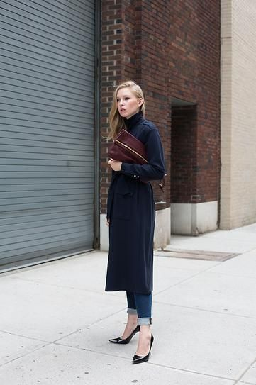 fall street style - navy trench coat over cuffed skinny jeans, worn with classic pointy toe heels and an oxblood clutch