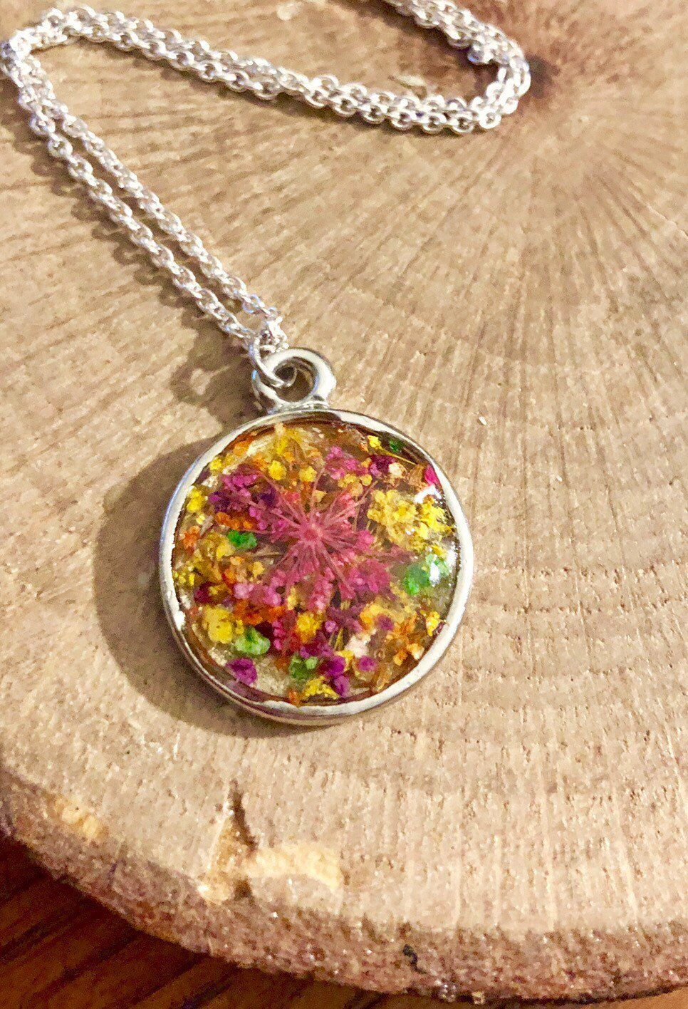 Handmade tiny dried flowers in resin circle pendant