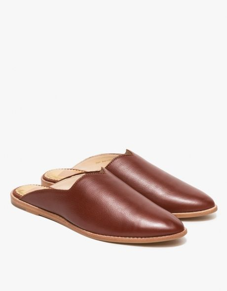 From Dolce Vita, a Moroccan-inspired tailored slide loafer in Brandy.  Features soft leather uppers, round toe, matching stitching, leather and canvas interior, synthetic outsole and small stacked heel.  •	Tailored slide loafer in Brandy •	Soft leather