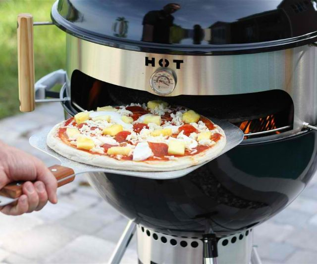 "The KettlePizza insert takes homely, mediocre 22.5"" kettle grills, such as Webers and Stoks, and magically transforms them into flashy, gourmet, pseudo-woodfired pizza ovens capable of putting New York slices, Chicago deep dish, and even the new Domino's to shame."