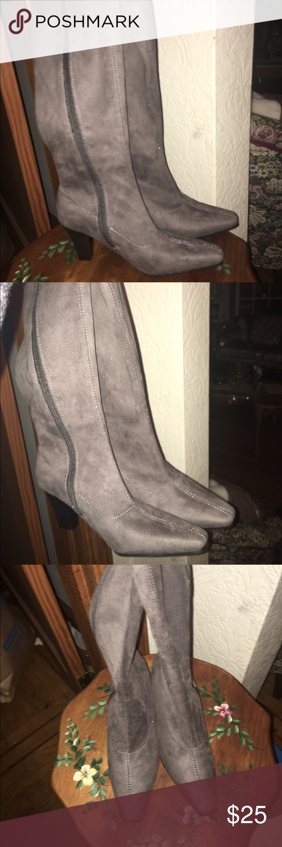 Grey boots Brand new boots that have been taking up space in my closet. I no longer have the box but they are in great condition . Size 6 1/2 Shoes Heeled Boots
