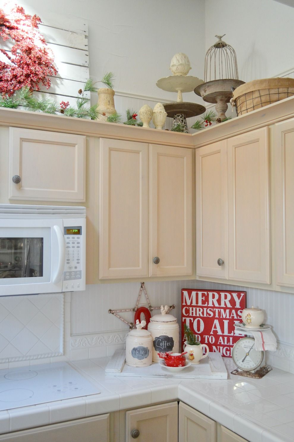 christmas in our cottage kitchen christmas kitchen kitchen decor above kitchen cabinets on kitchen cabinets xmas decor id=25431