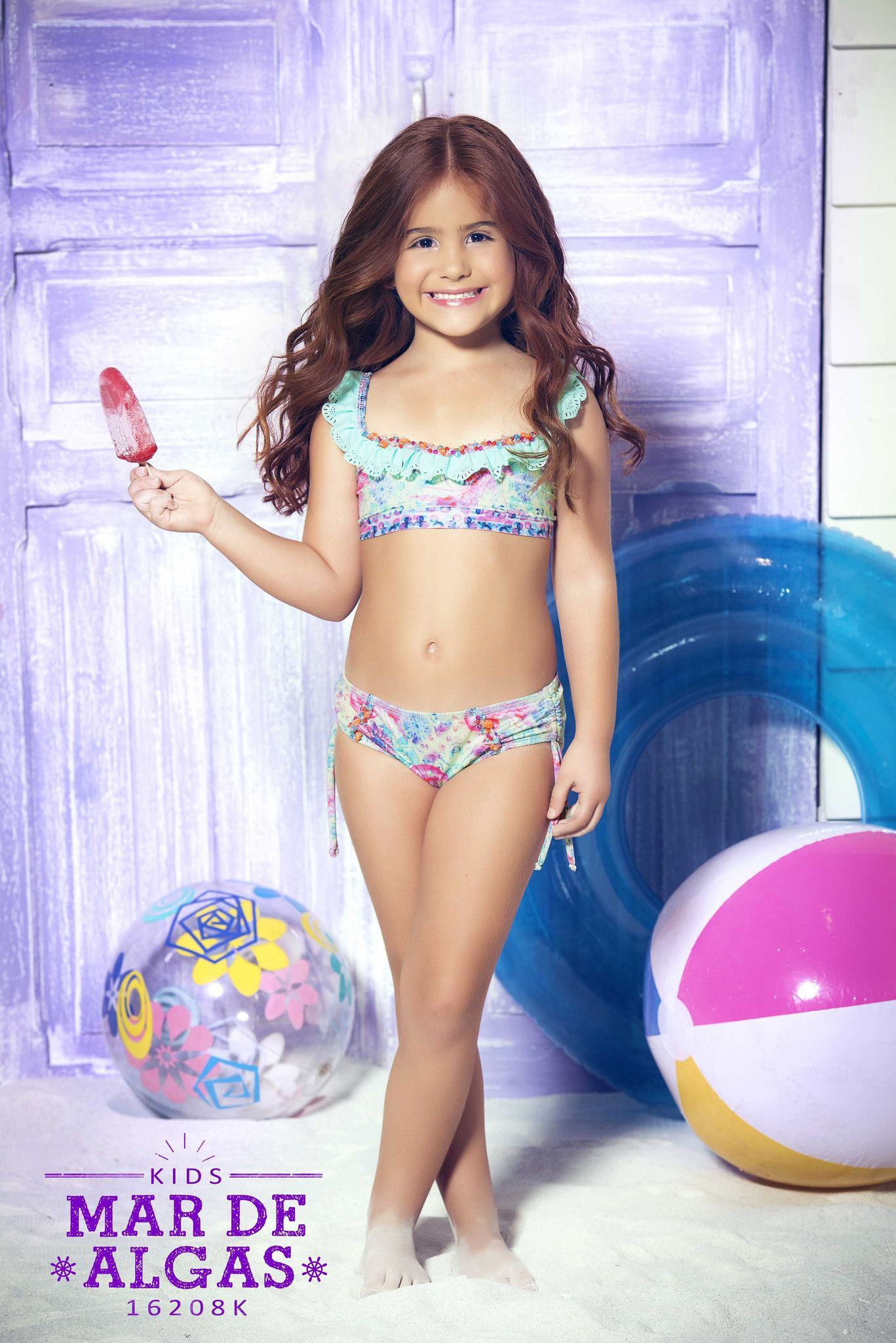 f8b9228820950 The most adorable children s bikini you have ever seen. Fall head over  heels with this matching designer bikini set from Mar de Rosas Swimwear.   marderosas