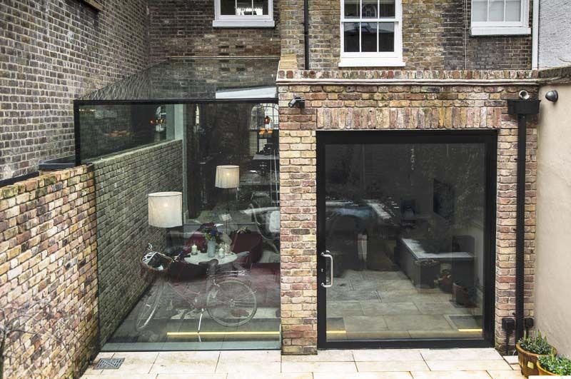 modern houses photos pivot door and frameless glass box. Black Bedroom Furniture Sets. Home Design Ideas