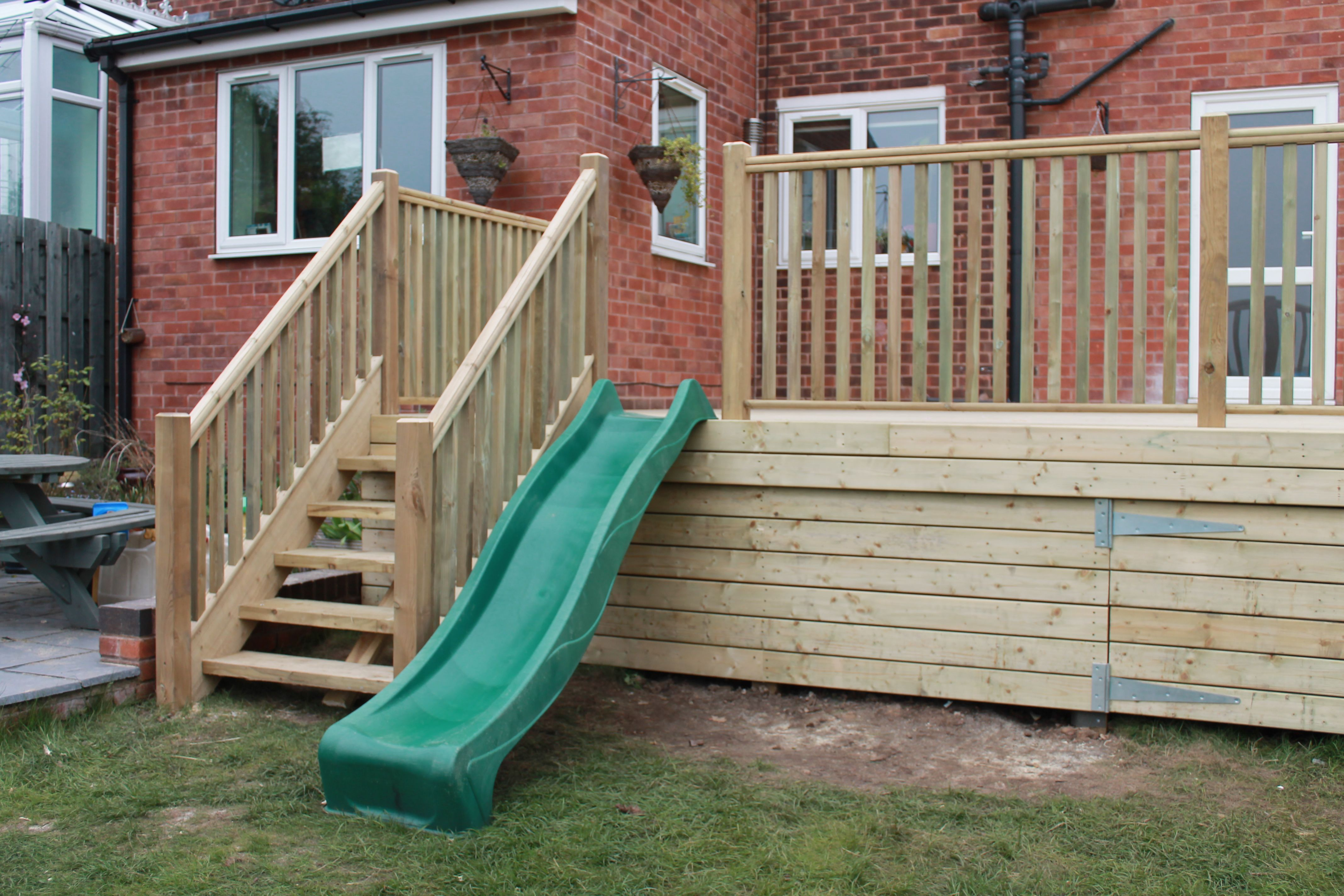 Raised Decking With Childrens Slide Play Area Completed In 400 x 300