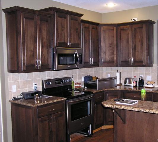 Dark kitchen cabinets, silver pulls | Stained kitchen ...