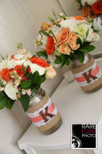 Rustic wedding. mason jar. centerpieces. Hydrangea, dahlias, roses, stock. Corals, white, ivory and burlap www.sevenstemsdesign.com