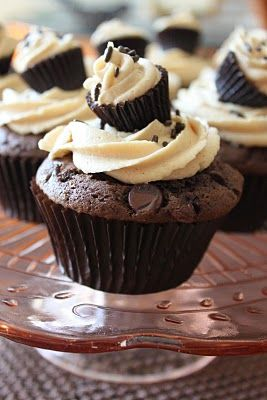 Chocolate cupcake with peanut butter frosting...that mini-cupcake is actually a peanut butter cup disguised to look like a cupcake...too cute!