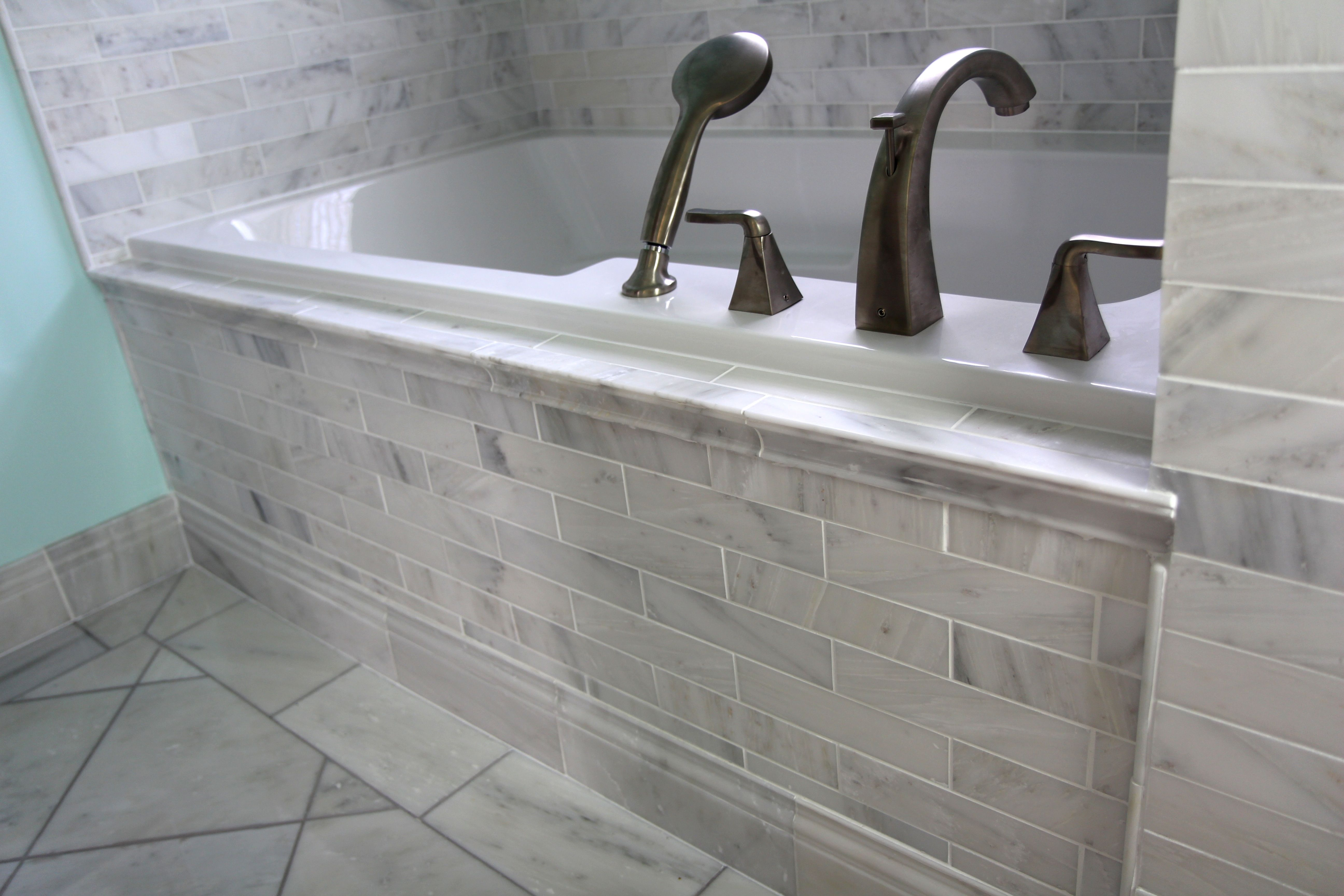 White Carrara Marble Tub Surround With Brushed Nickel Fixtures