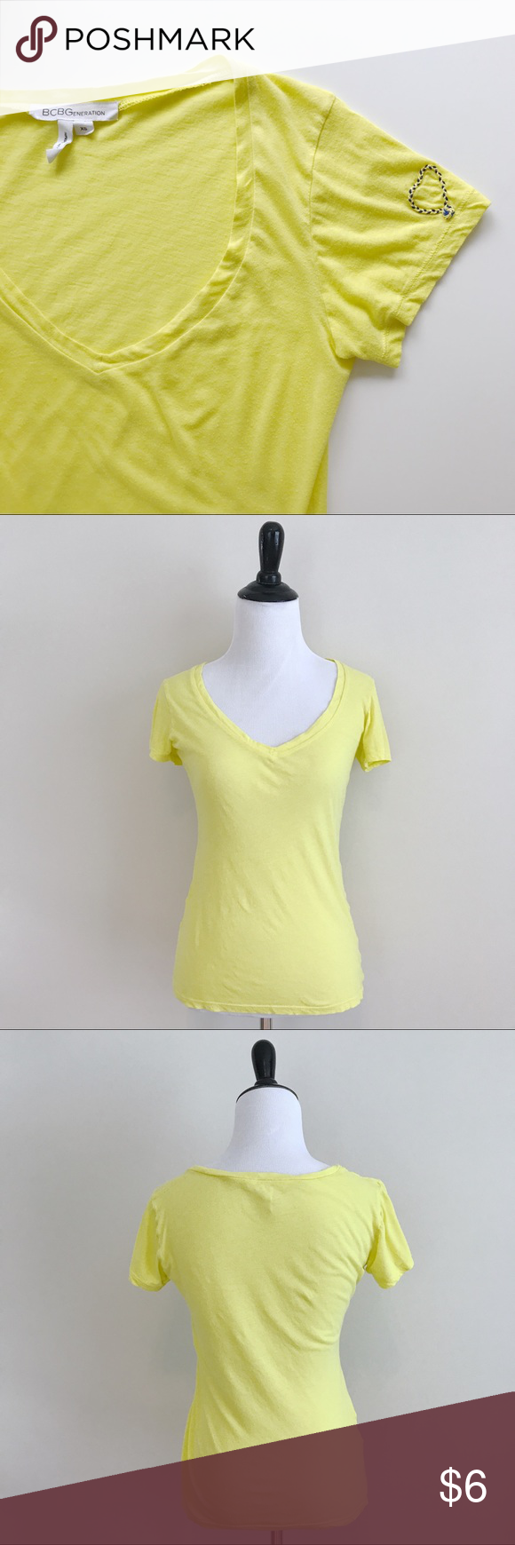 """❥ BCBGeneration Neon Yellow V-Neck Tee BCBGeneration v-Neck fitted tee. In great condition but the side seams are a bit off because I accidentally put in the washer 😂 hence the low price.   🔸Size/Color: XS/Neon yellow 🔸Condition: Great, but side seams are off 🔸Bust 15.5"""", length 23"""" measured flat 🔹Instagram: Missoh_J BCBGeneration Tops Tees - Short Sleeve"""