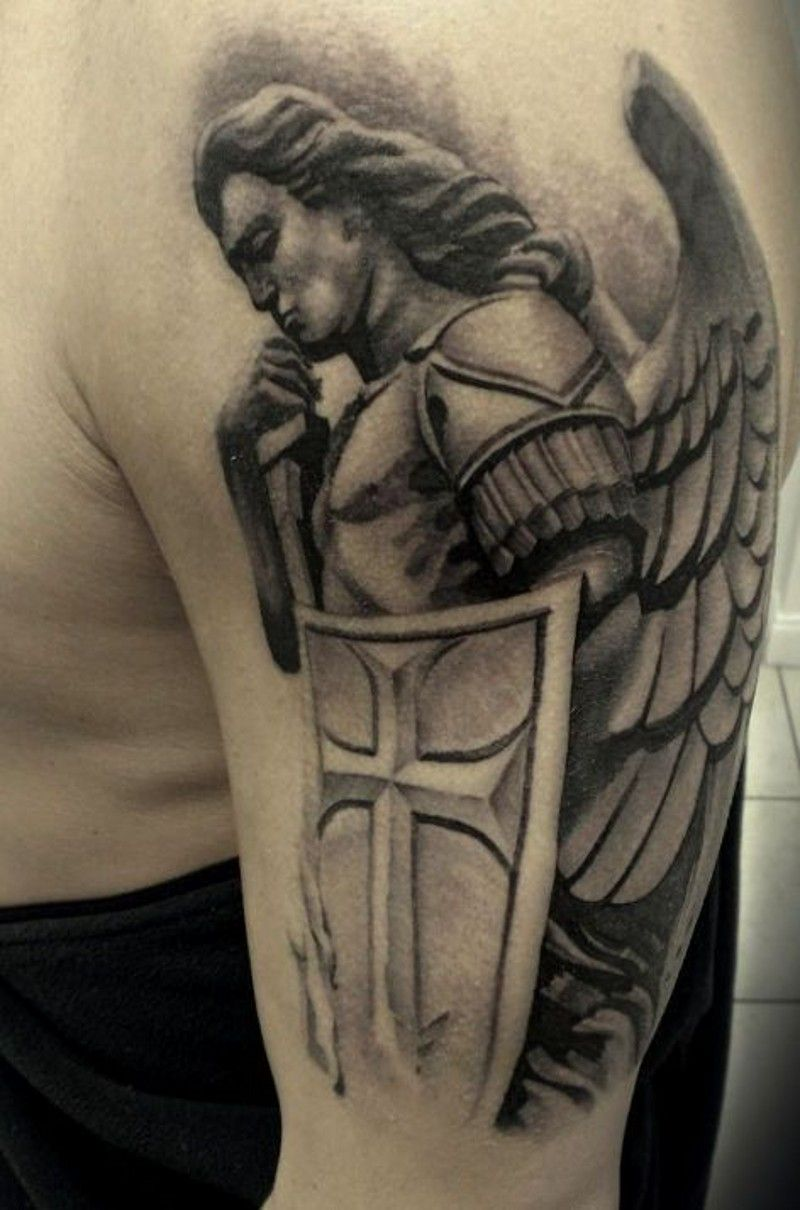 Guardian Angel With Shield Tattoo On Shoulder Guardian Angel Tattoo Designs Shoulder Tattoo Guardian Angel Tattoo