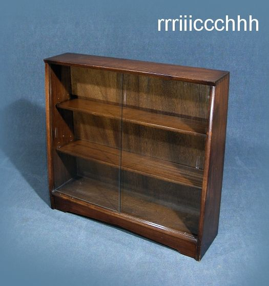 """A wonderful vintage mahogany glass front bookcase display cabinet Original """"Herbert Gibbs"""" plaque to back Double set of glass sliding doors to front Two"""